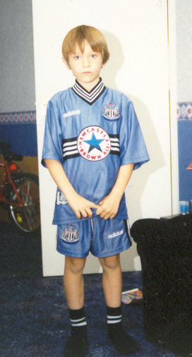 Me aged 8 in the 1996-97 away shirt